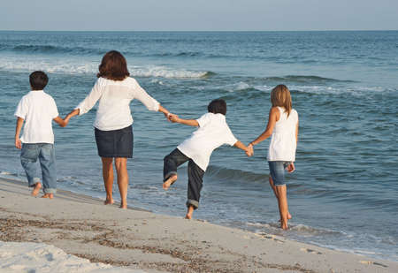 A family walking down the beach together.