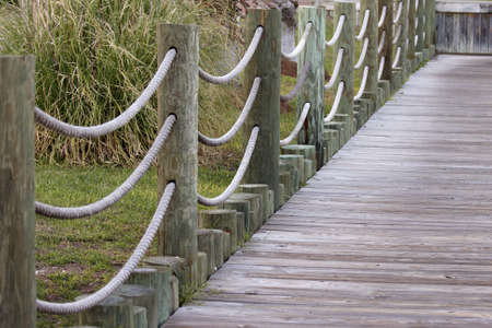 A wood walkway at a marina.