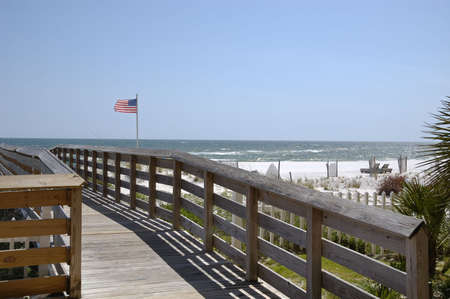 A boardwalk leading to the beach in Gulf Shores, AL. photo