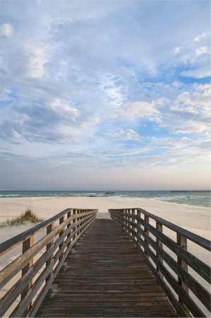 Scene of a walkway leading to the beach at Orange Beach AL.