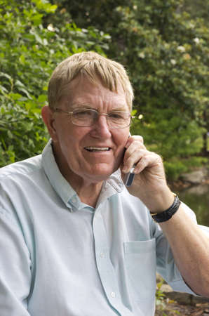 A senior man talking on the his cell phone. 版權商用圖片