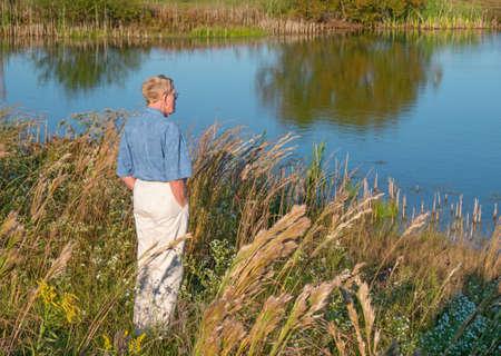 A senior man taking a walk and enjoying nature