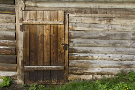Old wooden wall and door with rusty lock photo