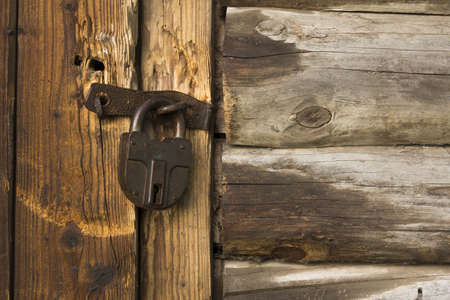Old wooden door with rusty lock photo
