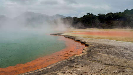 Champagne Pool. This photo of a New Zealand sulfur pond was not enhanced but still shows a broad range of colors while the steam can be rising from the water Banco de Imagens