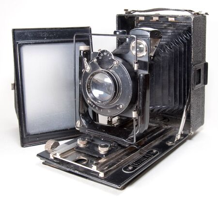 Old 9x12 large format camera with matte focusing screen (isolated on white)