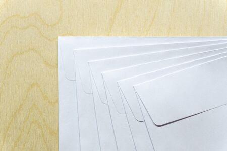 Blank white envelopes on wooden desk