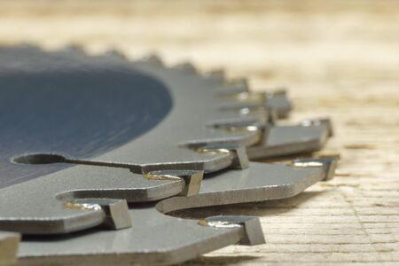 Circular saw blades laying on timber, details, closeup, shallow DOF Banco de Imagens