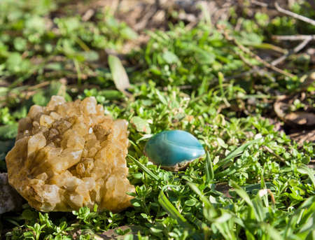 blue and yellow gemstone on grass Stock Photo