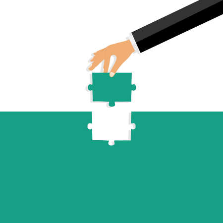 The hand inserts a puzzle. A hand with a puzzle inserts it into the hole. Flat design, vector illustration, vector.