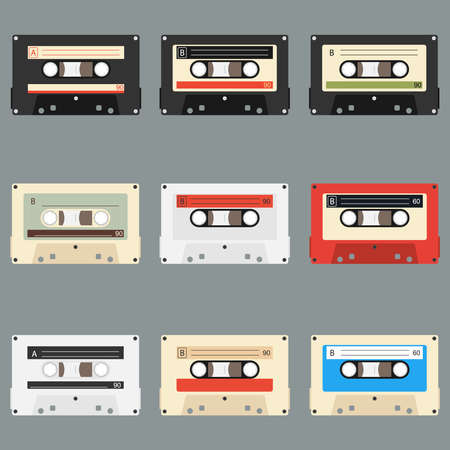 Old audio cassettes gray background. Collection of vector retro audio cassettes. Set of different colorful music tapes. Isolated on gray background. Banco de Imagens - 124949304