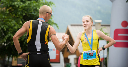 AUSTRIA, ST. ANTON AM ARLBERG - JULI 2, 2016: Man and Young Girl Shaking Their Hand in the Finish of the Panoramatic Lauf of the 14. Montafon Arlsberg Marathon