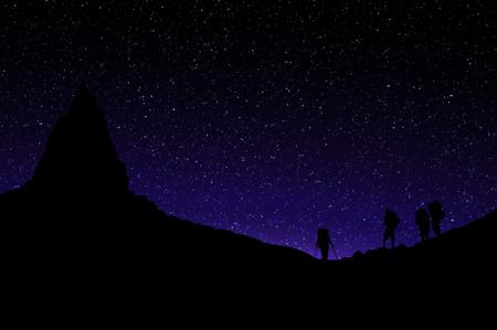Silhouette of Mountains Standing under Mountai Peak. Starry Sky. Reklamní fotografie