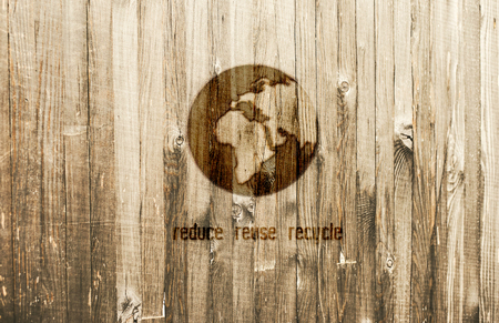 Planet Earth Burned in Wooden Background. Designed for Eco Banner. Text Reduce Reuse Recycle. Stock Photo