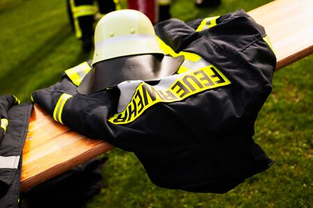 Germany, Niederstetten. September 2019. Firefighters uniform with text Feuerwehr, in inglish fireman. Фото со стока