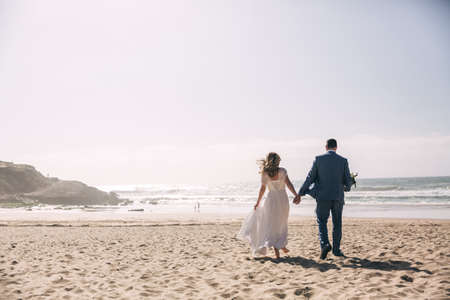 newlyweds on the ocean beach