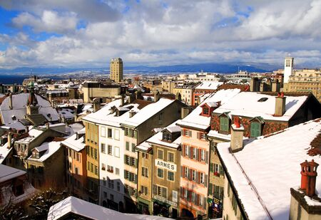 aereal: View of Lausanne in Winter with snowy roofs