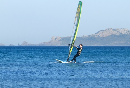Beginner girl windsurfs photo
