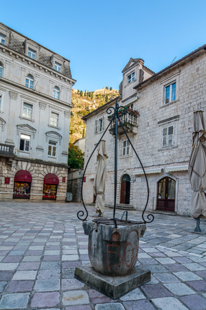 draw well: The square with an old Draw Well  in Kotor, Montenegro Stock Photo