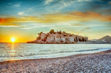 sveti: Sveti Stefan Island in Budva, Montenegro with a beautiful sunset in HDR