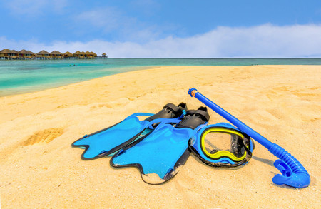 snorkling: Snorkling gear on the beach with water bungalows and the beach in Maldives