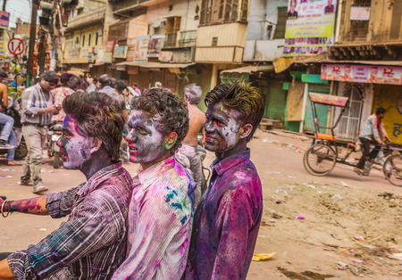 colored dye: New Delhi India  March 6 2015:Young people celebrate Holi festival in India
