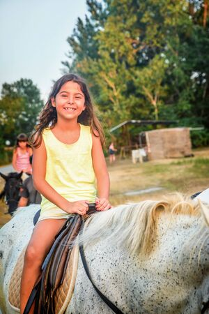 eight year old: Beautiful eight year old girl on the horse