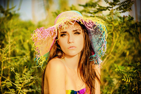 teen girl brown hair: Portrait of a beautiful teenage Caucasian girl with the summer hat
