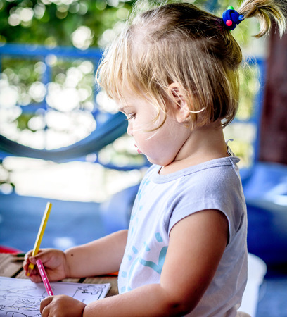 two year old: Beautiful Two year old girl drawing in a coloring book