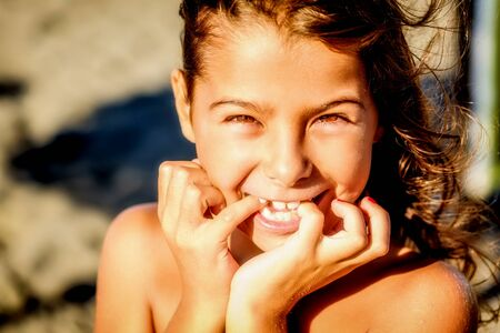 eight year old: Beautiful eight year old girl smiling on the beach Stock Photo