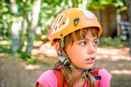 year profile: Profile of a beautiful eight year old girl in adventure park Stock Photo