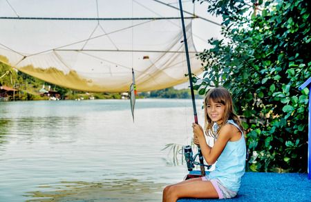 fishingpole: Little girl fishing on the river Bojana in Montenegro