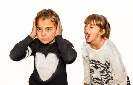 eight year old: Eight year old girl being angry and shouting at her sister. Isolated on white.
