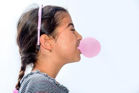 Portrait of a beautiful little girl blowing bubbles Stockfoto