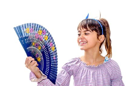 Beautiful little girl holding a fan