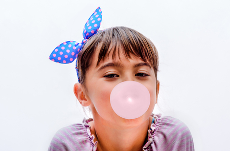 Portrait of a beautiful little girl blowing bubbles Banque d'images