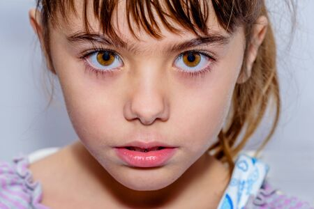 close up eyes: Portrait close up of a beautiful little girl with amazing brown  eyes