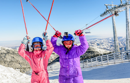 8 years old: Two little girls enjoying skiing on Kopaonik, Serbia Stock Photo