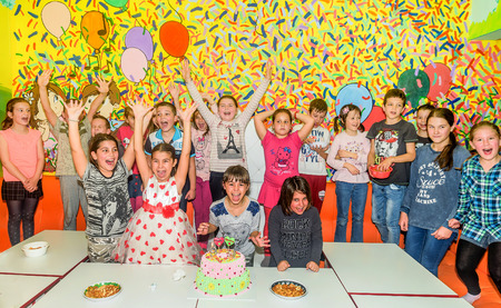 Tivat, Montenegro- April 9, 2016:Group of children celebrating birthday with  birthday cake