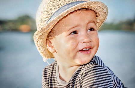 Portrait of a cute little boy with summer hat