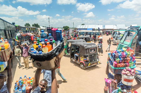 mwanza: Mwanza, Tanzania- March 25, 2016:  Street vendors selling goods at Bus Station in Mwanza, Tanzania