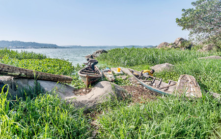 mwanza: Mwanza, Tanzania- March 26, 2016: Fisherman poors out water from a  boat  on  Lake Victoria near Mwanza, Tanzania