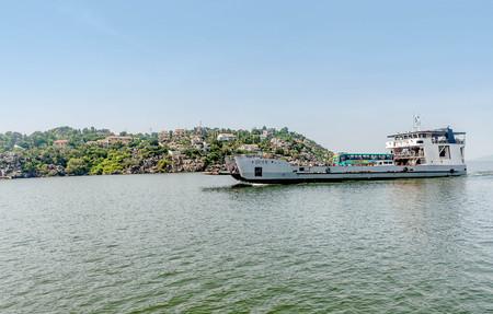 Mwanza, Tanzania- March 27, 2016: Ferry with cars and people passing by Mwanza  on Lake Victoria, Tanzania Editorial