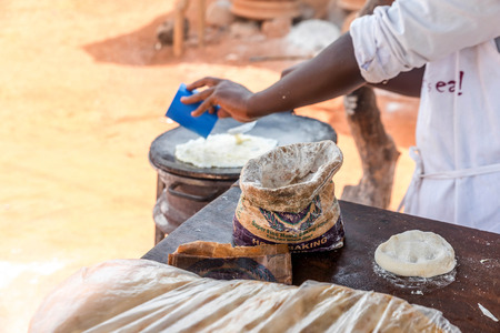 ugandan: Uganda, Africa- March 31, 2016:  Preparation of traditional Ugandan breakfast Rolex made with chapati and eggs