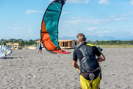 kiter: Ulcinj, Montenegro- July 18, 2016: Kitesurfer trying to lift his power Kite in the air on the beach in Ulcinj, Montenegro