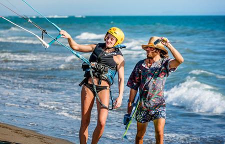 Ulcinj, Montenegro- July 18, 2016: Woman holding  Kitesurf power kite on the beach in Ulcinj, Montenegro