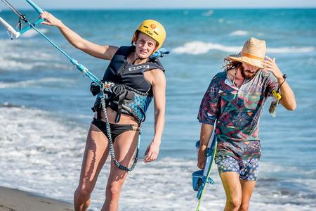 kitesurf: Ulcinj, Montenegro- July 18, 2016: Woman holding  Kitesurf power kite on the beach in Ulcinj, Montenegro