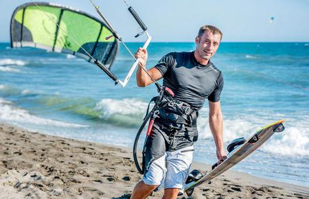 kitesurf: Ulcinj, Montenegro- July 18, 2016: Kitesurfer with  Kitesurf power kite on the beach in Ulcinj, Montenegro