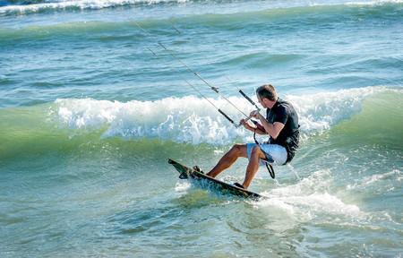 Ulcinj, Montenegro- July 18, 2016: Kitesurfer riding on Kiteboard on the beach in Ulcinj, Montenegro Editorial