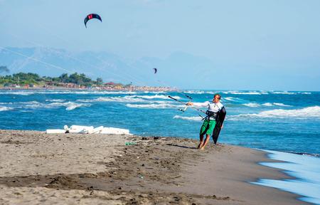 kitesurf: Ulcinj, Montenegro- July 18, 2016:Kitesurfer with  Kitesurf power kite on the beach in Ulcinj, Montenegro